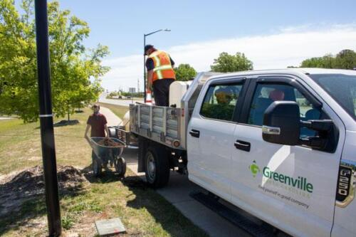 Greenville works truck with worker and child